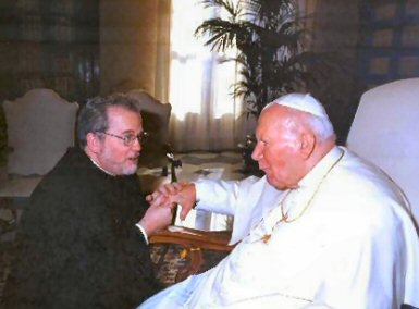 Father Al Masluk, Pastor, meets with His Holiness Pope John Paul II on December 30, 2004. The Holy Father bestowed his blessing upon the people of Saint Martha Parish. Father Al and some of his priest classmates were in Rome to celebrate the end of their silver jubilee year.